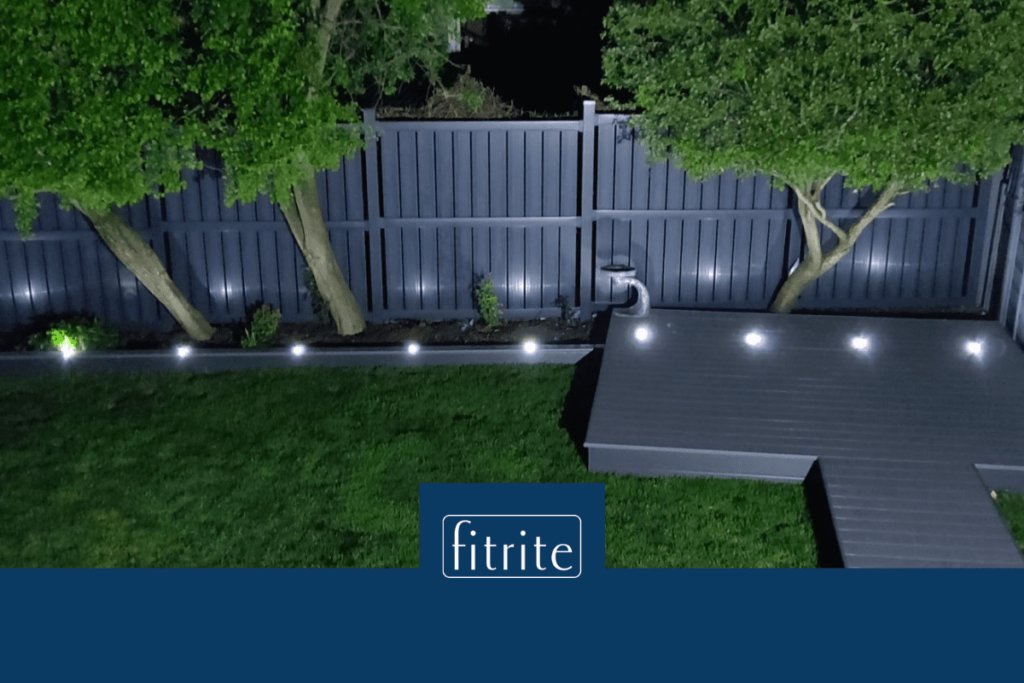 small decked area in garden with lighting and pathway