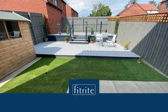 small garden with decking in light grey and dark grey
