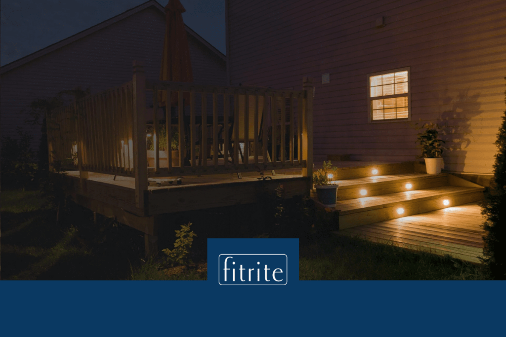 decking at night time with lighting in the steps