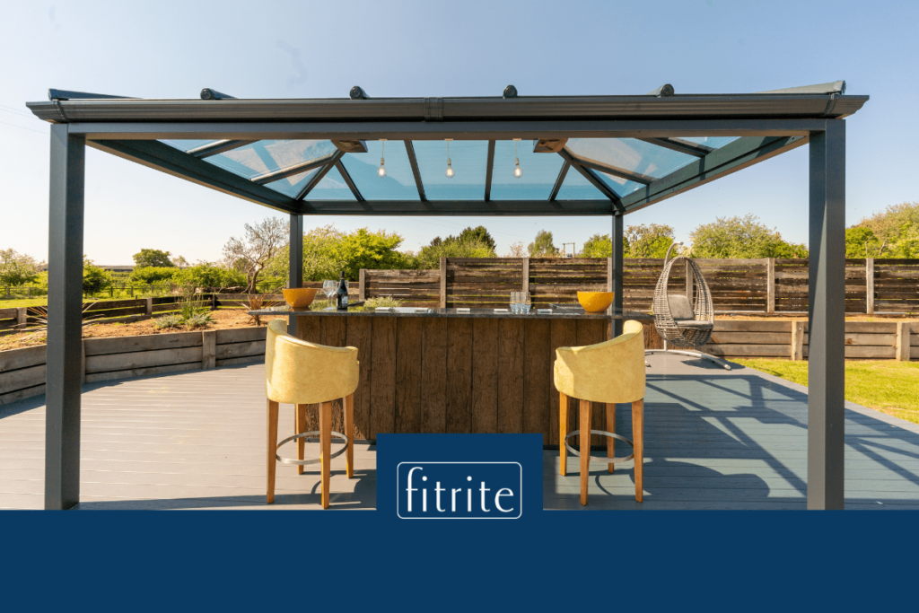 outdoor decking space in light grey with bar and gazebo