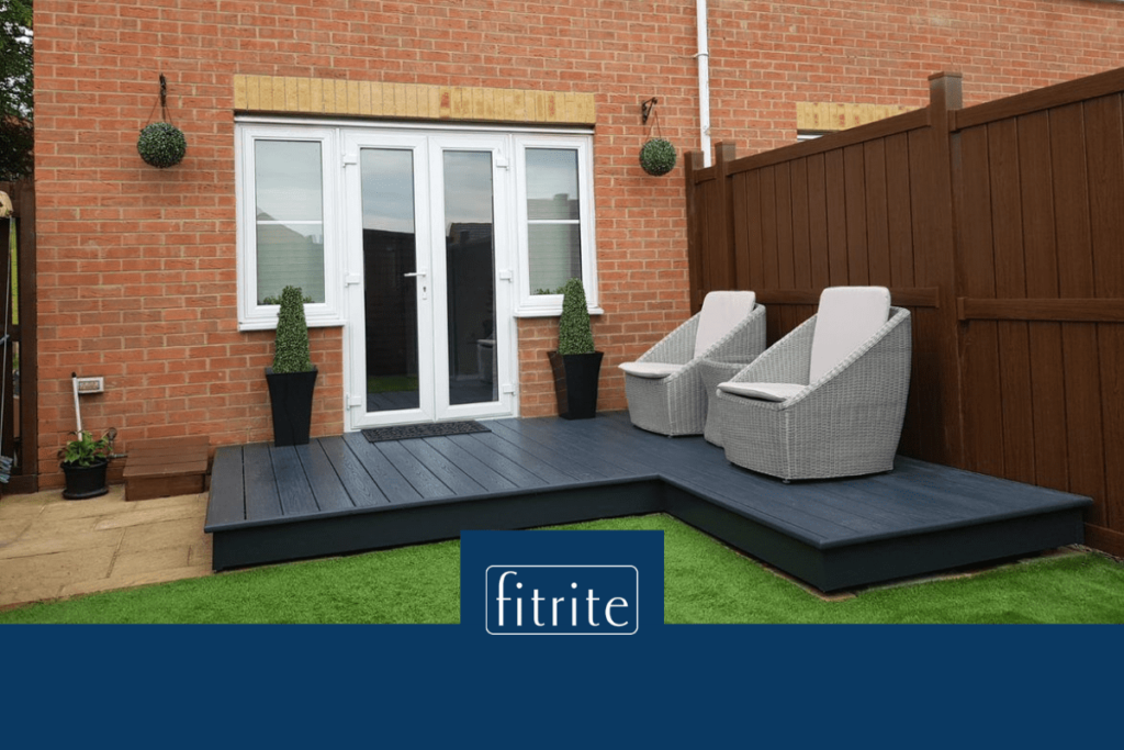 L shape decking in grey colour with outdoor chairs