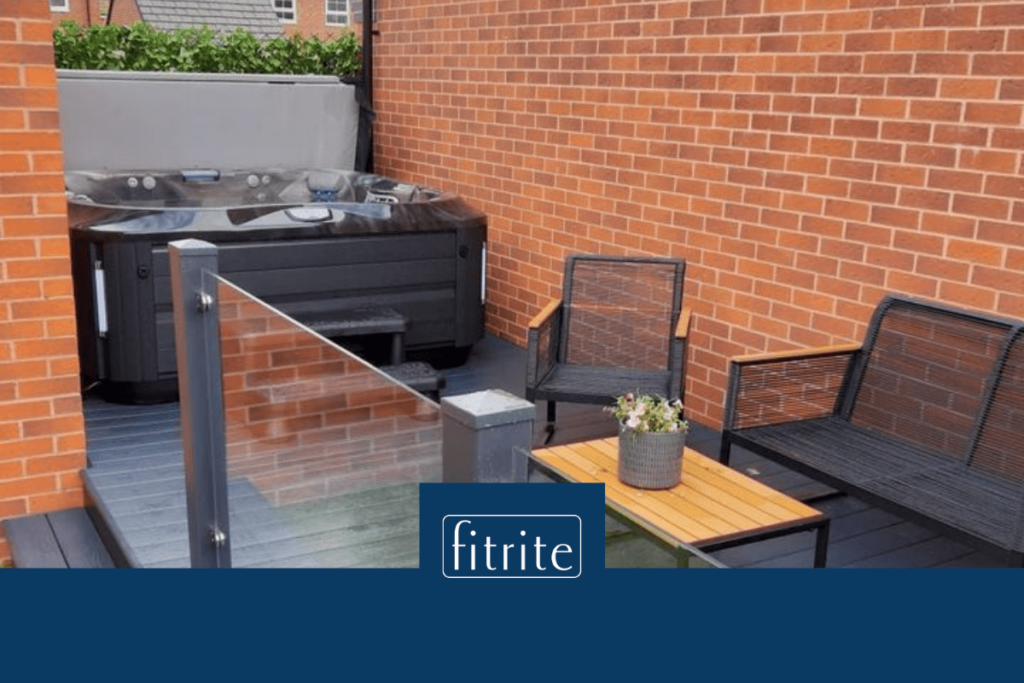 new hot tub on dark grey pvc decking with seating area